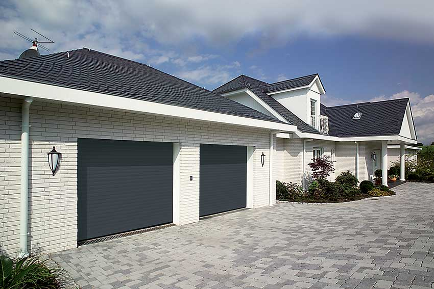Twin roller Hormann garage doors in grey
