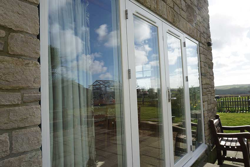 White alu clad french doors
